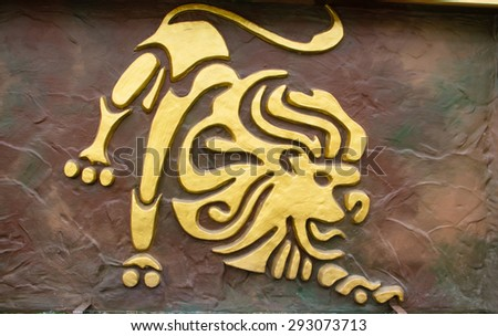Leo sign of horoscope on the wall - stock photo