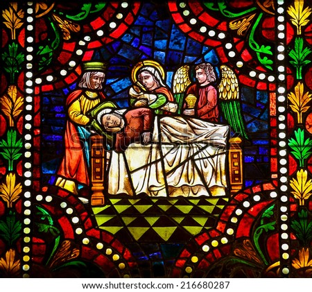 LEON, SPAIN - JULY 17, 2014: Stained glass window depicting Mary on her death bed in the cathedral of Leon, Castille and Leon, Spain. - stock photo