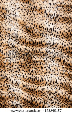 Leopard print fur blanket background rippled in vertical position - stock photo