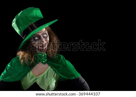 Leprechaun girl looking to copyspace, concept ireland and st. patrick´s day - stock photo