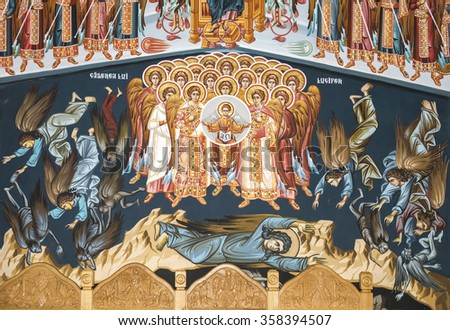 LEPSA, ROMANIA - MAY 02, 2015: The story of Lucifer's fall and his acolytes from paradise into hell depicted in the fresco on the walls of Lepsa Monastery in Vrancea County, Romania - stock photo