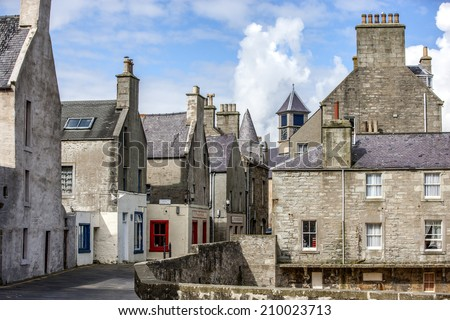 Lerwick, Shetland, Scotland, United Kingdom. Street View of the old city of 400 years (17th century) with its characteristic granite houses in northern Europe. - stock photo