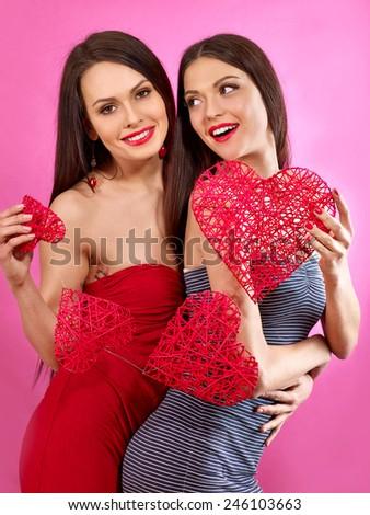 Lesbian women holding heart symbol. Valentin day. - stock photo