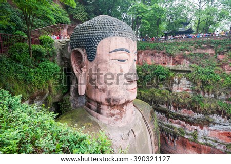 LESHAN - AUG 2: view of Leshan Buddha statue on August 2, 2014 in Leshan, China. Leshan Buddha is a UNESCO world heritage object and the world's largest buddha statue, measuring 71 meters in height. - stock photo