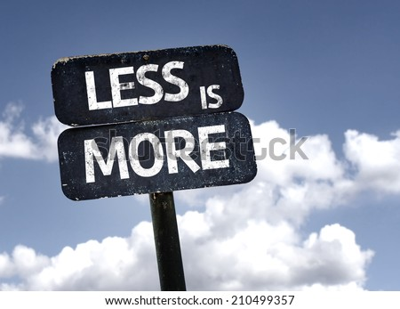 Less is More sign with clouds and sky background - stock photo