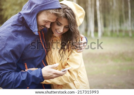 Let check the weather on smart phone - stock photo