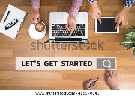 LET'S GET STARTED man touch bar search and Two Businessman working at office desk and using a digital touch screen tablet and use computer, top view - stock photo