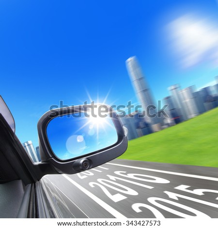 Lets go new year 2016 - Drive to city, car and rear view mirror on the road, concept for business, speed or success - stock photo
