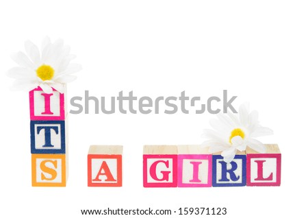 Letter blocks spelling its a girl with flowers. Isolated on a white background - stock photo