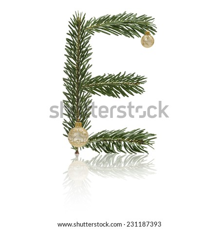 Letter E made from fir branches, decorated with christmas balls and reflection. - stock photo