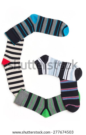 Letter  G made from colorfull socks isolated on white - stock photo