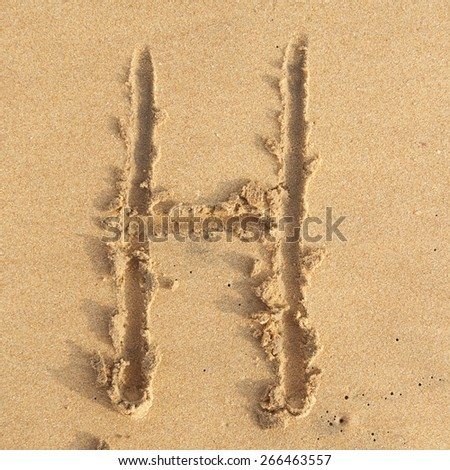 """letter """"H"""" in the sand - stock photo"""
