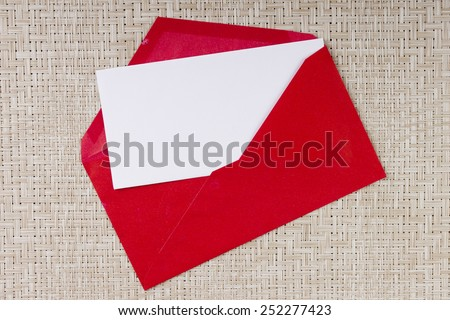 Letter in a red envelope for invitations to visit. - stock photo