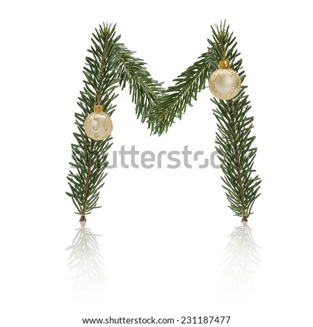 Letter M made from fir branches, decorated with christmas balls and reflection. - stock photo