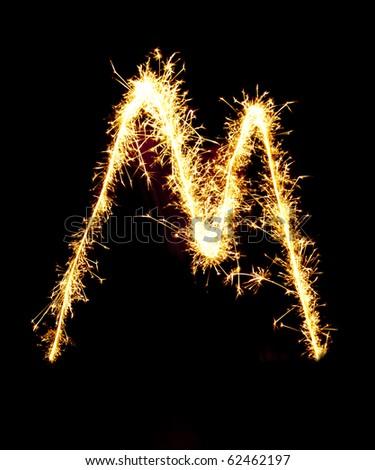 Letter M made of sparkler - stock photo