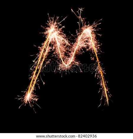 Letter M. Real sparkler alphabet - stock photo