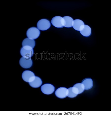 "letter of Christmas lights on a dark background, the letter C, ""blue bokeh"" - stock photo"