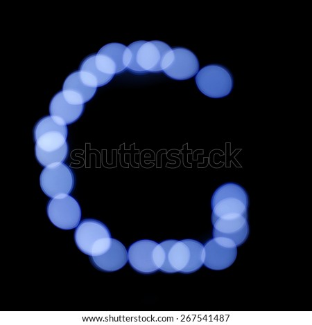 "letter of Christmas lights on a dark background, the letter G, ""blue bokeh"" - stock photo"