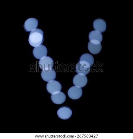 """letter of Christmas lights on a dark background, the letter V, """"blue bokeh"""" - stock photo"""