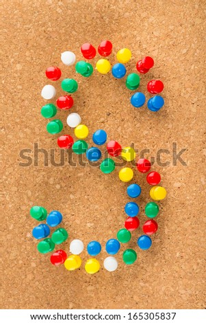 "Letter ""S"" made of push pins on wooden cork background - stock photo"