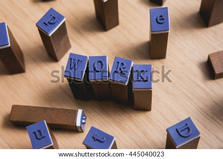 "Letter spelling the words ""WORK"" on wooden stamper - stock photo"