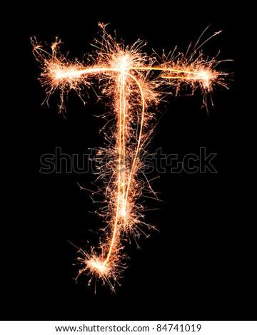 Letter T. Real sparkler alphabet - stock photo