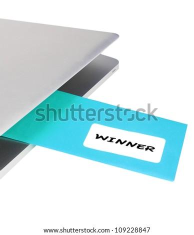 Letter WINNER flying out of modern laptop - stock photo