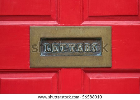 Letterbox with a red door background - stock photo