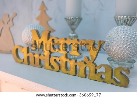 Letterpress wood type Merry Christmas on a fireplace - stock photo