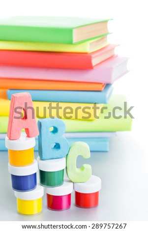 letters abc and stack of books on a white background - stock photo