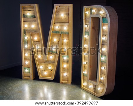 letters M D with wood and light - stock photo