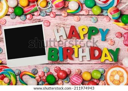 letters of cookies and happy birthday photo frame - stock photo