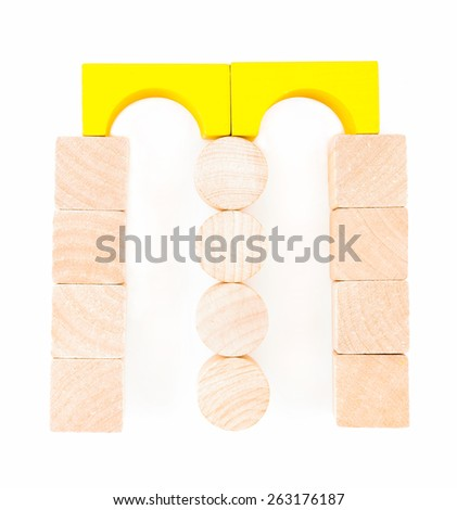 "Letters of the alphabet, composed of wooden toy blocks. The letter ""M"" isolated on a white background - stock photo"