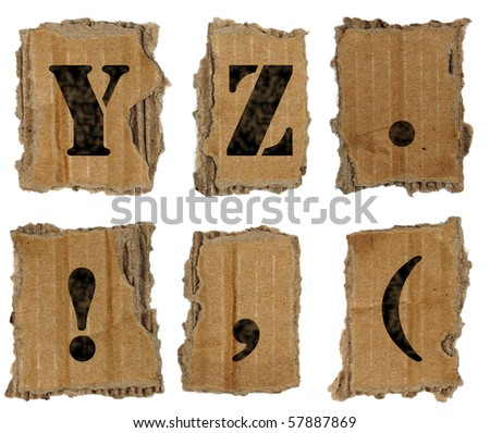 Letters on the lacerated cardboard - stock photo