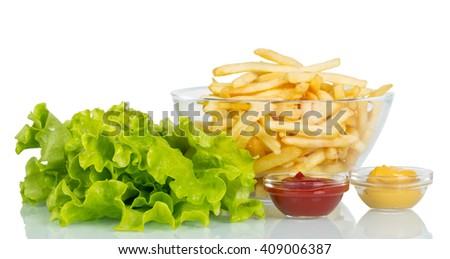 Lettuce, a bowl of French fries and sauces isolated on white background. - stock photo