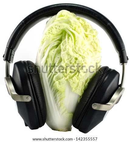 lettuce and Headphones isolated on white background - music concept - - stock photo