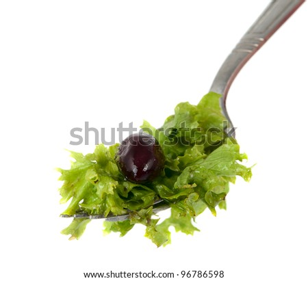 lettuce on a fork isolated on white background - stock photo