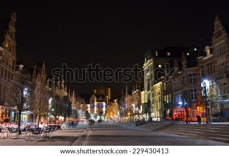 LEUVEN, BELGIUM, FEBRUARY 24, 2014: View over illuminated old market square in belgian leuven, which is considered to be the longest bar in europe. - stock photo
