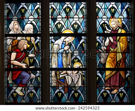 LEUVEN, BELGIUM-SEPTEMBER 12, 2014: Stained glass window in Saint Anton's Chapel. The chapel was built circa 1329. - stock photo