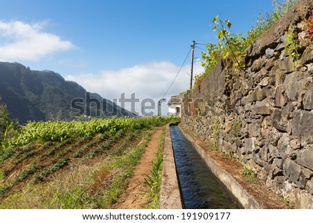 Levada, irrigation canal with hiking path at Madeira Island, Portugal - stock photo