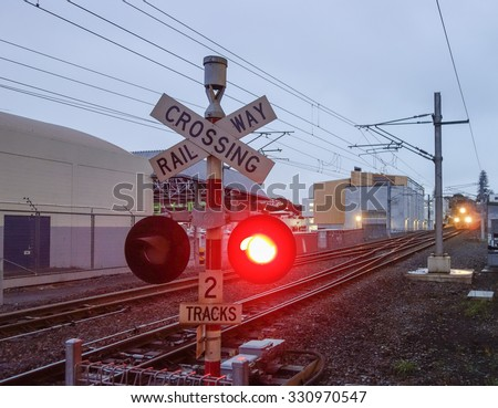 Level crossing without a gate or barrier traffic sign - stock photo