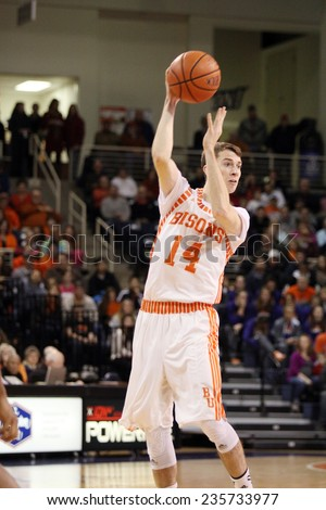LEWISBURG, PA. - NOVEMBER 28: Bucknell's #14 Chris Hass passes the ball during a basketball game against Penn Statel on November 28, 2014 Sojka Pavilion in Lewisburg, PA. - stock photo