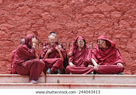 LHASA - JUNE 28: monks waiting in front of Ganden monastery for their examination results on June 28 , 2013 in Lhasa, Tibet. Passing the exams means they are eligible to become a higher lama.  - stock photo