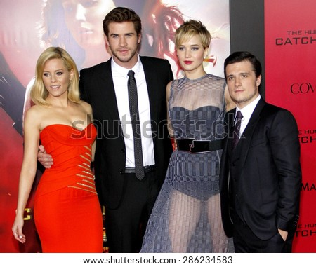 "Liam Hemsworth, Elizabeth Banks, Jennifer Lawrence and Josh Hutcherson at the Los Angeles premiere of ""The Hunger Games: Catching Fire"" held at the Nokia Theatre in Los Angeles on November 18, 2013. - stock photo"