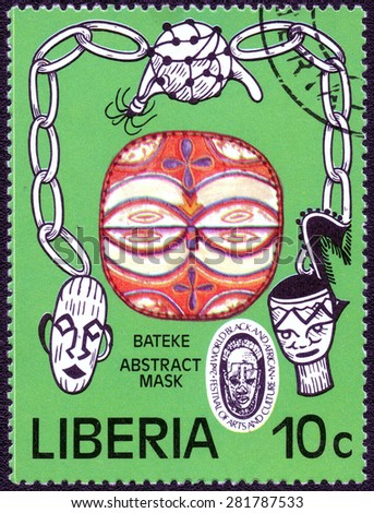 "LIBERIA - CIRCA 1968: a stamp printed in the Liberia shows a series of images ""African tribal mask"", circa 1968  - stock photo"