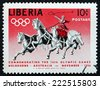 LIBERIA - CIRCA 1956: a stamp printed in the Liberia shows Classic Chariot Race, 1956 Summer Olympic Games, Melbourne, circa 1956 - stock photo