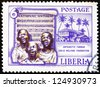 LIBERIA - CIRCA 1957: a stamp printed in the Liberia shows Singing Boys and National Anthem, Founding of the Antoinette Tubman Child Welfare Foundation, circa 1957 - stock photo