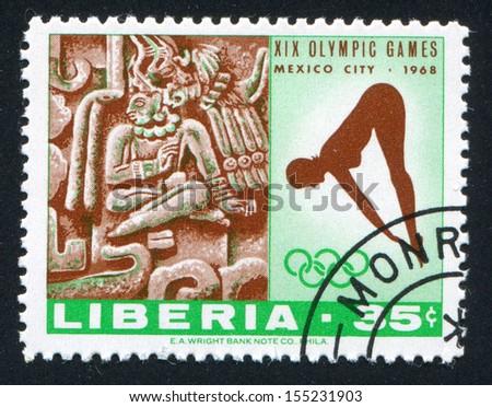 LIBERIA - CIRCA 1968: stamp printed by Liberia, shows Woman diver and Xochicalco from ruins near Cuernavaca, circa 1968 - stock photo