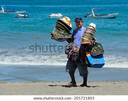 LIBERIA-MARCH 18: Vendor sells hats on March 18 in Liberia, Costa Rica. Costa Rica welcomed some 2.4 million tourists during 2013, an increase of 3.6 percent compared to 2012 - stock photo