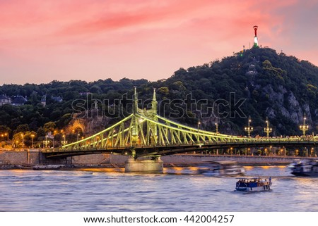 Liberty Bridge at sunrise with the liberty statue in Budapest, Hungary - stock photo